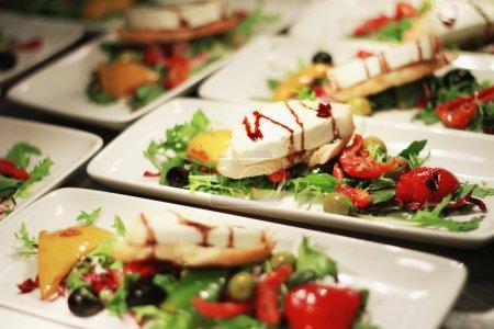 preparing salad in white plates