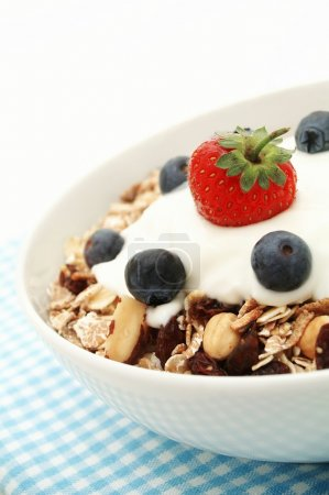Photo for Muesli with blueberries and strawberry for healthy breakfast - Royalty Free Image