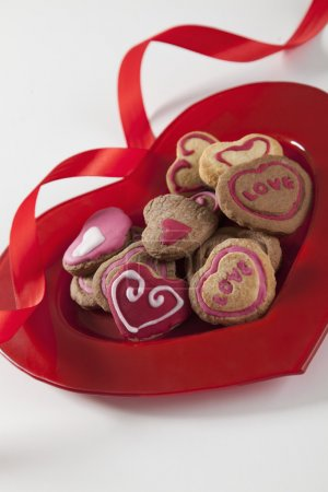 Photo for Heart shape cookies on red plate. - Royalty Free Image