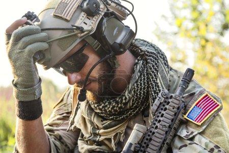 American Soldier looking down