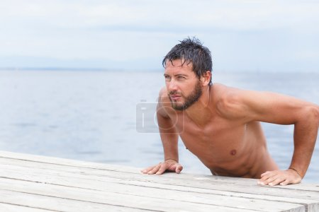 Portrait of Handsome Man with No Shirt at the Sea