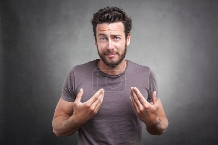 Frontal portrait of surprised adult man getting un...