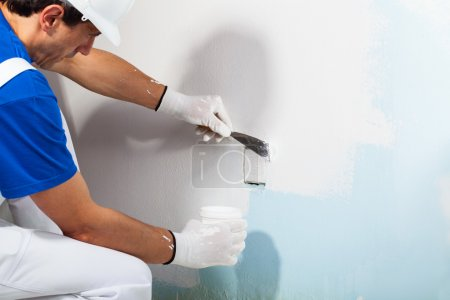 Close-up Of Professional Workman Applying Plaster ...