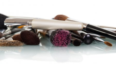 Cosmetic brushes for makeup isolated on white.