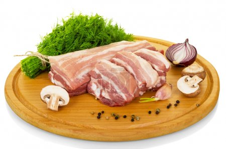 Fresh raw pork, dill and spices isolated on white .