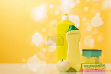 Cleaning products  on yellow
