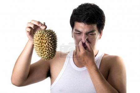 Asian man with bad smell of durian in white background
