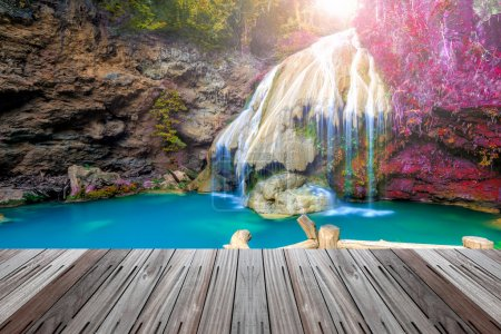 wonderful waterfall in thailand  with wooden floor