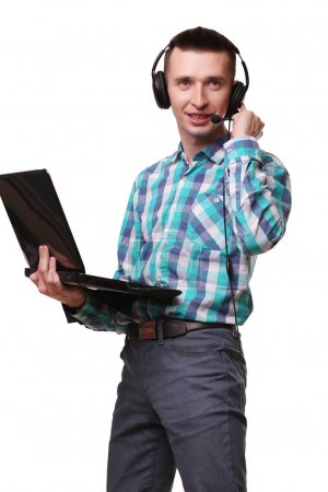Young Man with Headset Holding Laptop - Call center man with hea