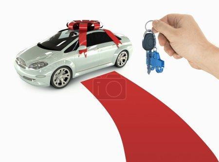 Photo pour Une main tient la clé de la nouvelle voiture. Tapis rouge pour un client spécial . - image libre de droit