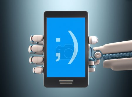 Photo for Robot hand holding a cell phone - Royalty Free Image