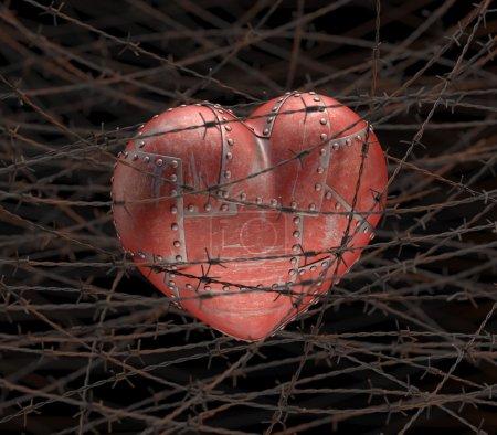 Foto de Corazón de metal con alambre de púas alrededor . - Imagen libre de derechos