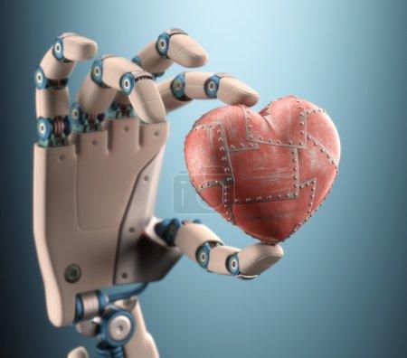 Photo pour Robot main tenant un coeur métallique. Tracé de détourage inclus. - image libre de droit