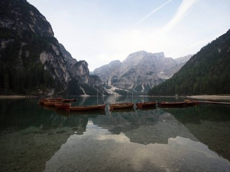 Photo for Panorama wooden rowing boat reflection view of Lago di Braies Pragser Wildsee alpine mountain lake in Prags Dolomites alps South Tyrol Italy Europe - Royalty Free Image