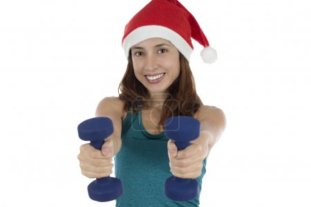 Young Christmas fitness woman with dumbells doing fitness