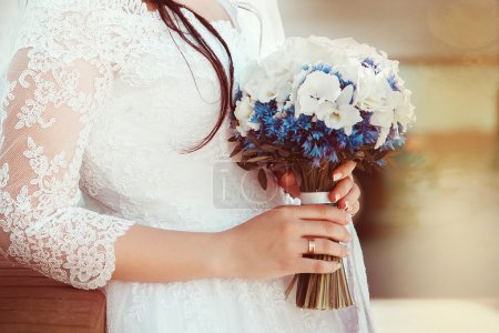 Bride on wedding with bouquet