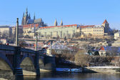 Snowy Prague gothic Castle above River Vltava, Czech Republic