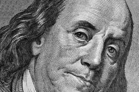 Franklin on dollar bill.
