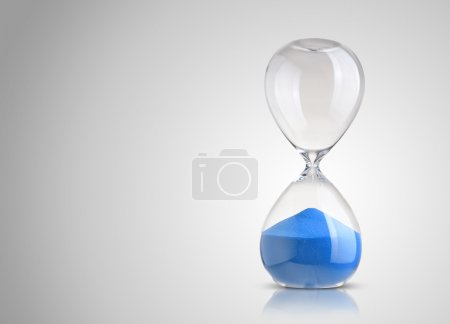 Hourglass on gray background