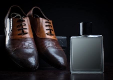 Photo for Men's shoes and perfume on a black background - Royalty Free Image