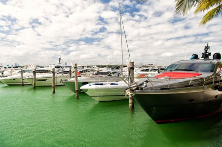 Yachts in miami marina bay at south beach with cloudy sky
