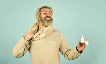 Happy hipster presenting best remedy. Nasal drops ...