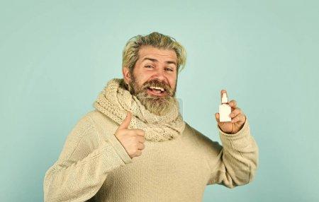 Best cold remedy. helpful nasal spray. man use nas...