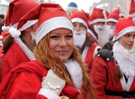 Smiling girl at the Santa Clause parade
