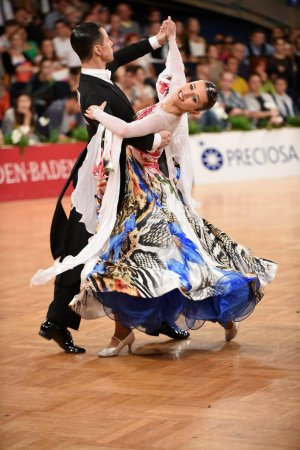 Photo for Stuttgart, Germany - August 16,2014:  An unidentified dance couple in a dance pose during Grand Slam Standart at German Open Championship, on August 16, in Stuttgart, Germany - Royalty Free Image