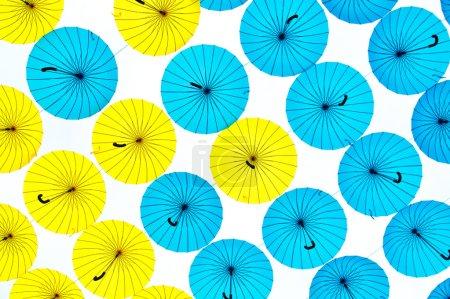 Photo pour Bright colorful umbrellas against white background - image libre de droit