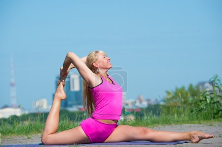 Young woman practicing yoga in nature