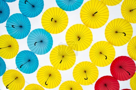 Bright colorful yellow, red and blue umbrellas background