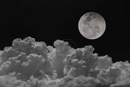 Photo for Backgrounds night sky of the full moon with clouds. - Royalty Free Image