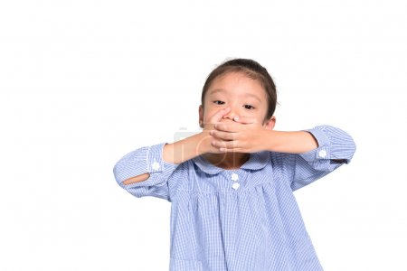 Little asian girl put hand closing her mouth with isolate backgr