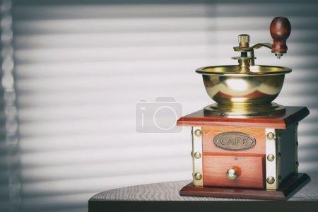 Coffee grinder on table