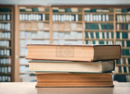 Three books on table