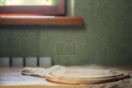 Photo for Cutting board on kitchen table - Royalty Free Image