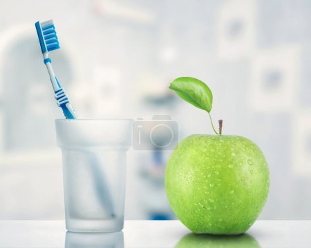 Toothbrush and green apple