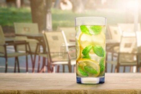 Glass of lemonade on table