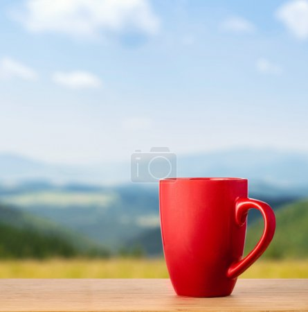 Red cup on wooden table