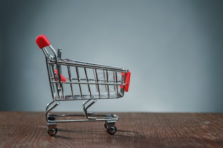 Shopping cart on wooden table