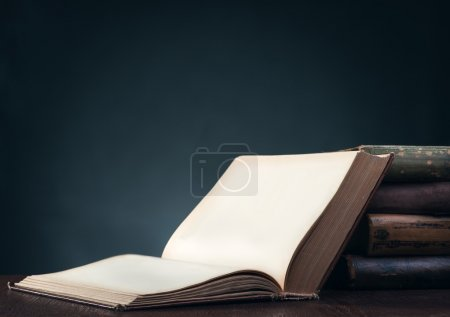 Photo for Old books on wooden table - Royalty Free Image