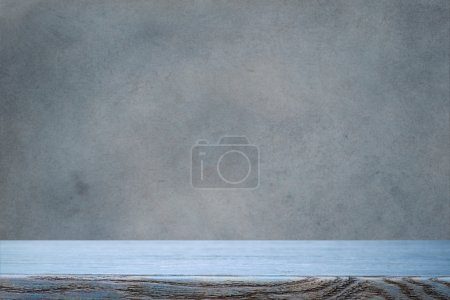 Photo for Blue table top and grunge wall - Royalty Free Image