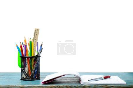 copy-book, pen and pencils