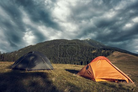 tents in mountains during storm