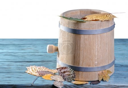 Wine barrel with autumn leaves