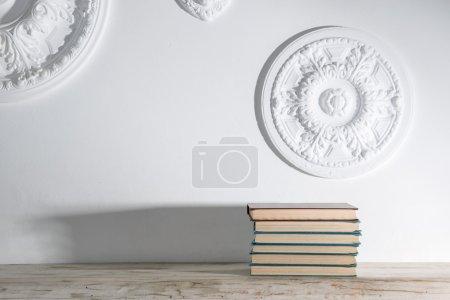Books on wooden shelf