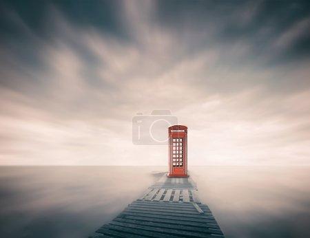Telephone booth near sea