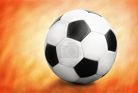 Soccer ball over orange background