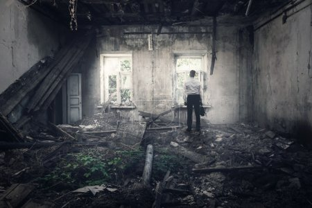 Photo for The man returned to the destroyed house - Royalty Free Image